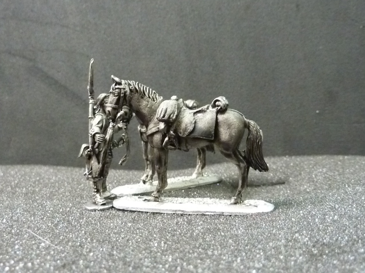 French Dragoon horse holder and horses